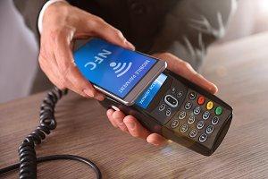 Businessman paying through mobile