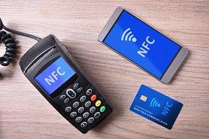POS card and mobile on wood nfc
