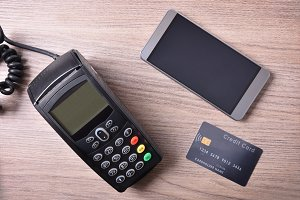 POS card and mobile on wood table