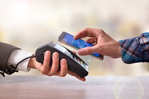 Customer paying a merchant with nfc
