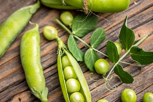 Fresh green peas and pods
