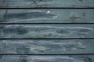 Dark turquoise old wooden fence