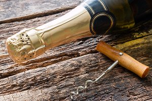 champagne bottle and corkscrew