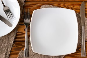 white empty plate with cutlery