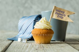 Fathers day concept - cupcake, tie, present