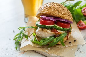 Chicken grill burger on wood background
