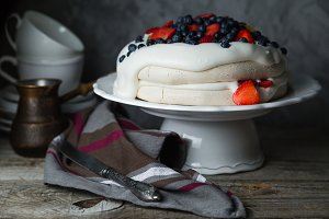 Pavlova cake with wipped cream and berries