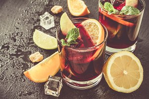Sangria and ingredients on stone background