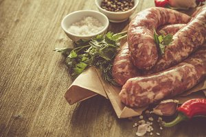 Raw sausages with herbs and spices