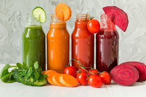 Selection of colorful vegetable juices in glass jars