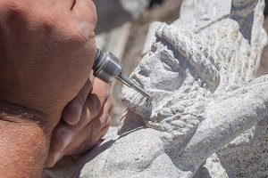 Sculptor working on stone