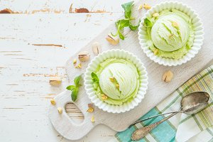 Pistachio ice cream in white bowl