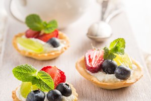 Small berry cakes on white background