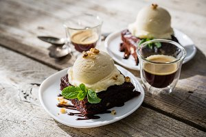 Chocolate brownie with vanilla ice cream, nuts and mint