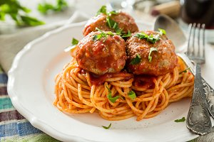 Meat balls and spaghetti on white plate