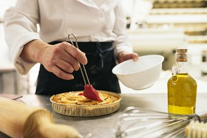 Woman pastry chef decorating dessert