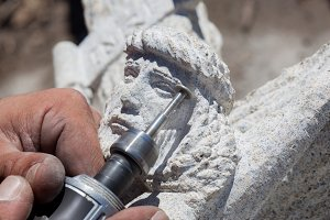 Stone sculptor working