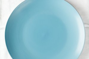 empty blue dish on a white