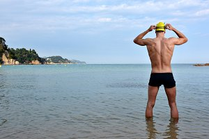 swimmer training on the beach