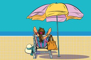 Girl in a deckchair on the beach