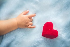 baby hands with red Heart
