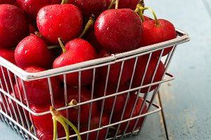 Delicious cherries in a basket