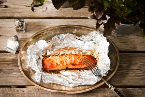 Salmon Steak grilled, wrapped in foils that