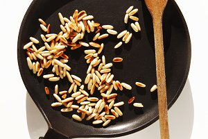 roasted pine nuts in pan