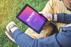 Man using digital Tablet PSD Mockup
