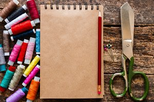 colored thread, scissors and notepad