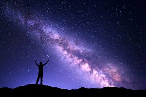 Milky Way and silhouette of a man