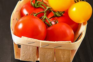 Top view of fresh tomatoes, isolated on dark background