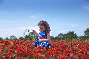 Girl in blossom field