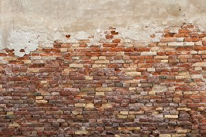 grunge brick wall damaged plaster