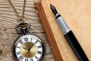 Watch, fountain pen and note book