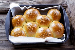 bread buns on a baking sheet
