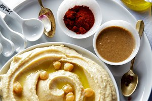 hummus and spices on a blue