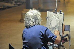 A street artist painting a portrait