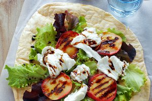 Caprese salad with fresh lettuce