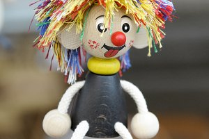 Doll hanging from a spring