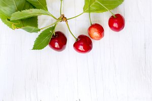 Cherries on wooden background 2