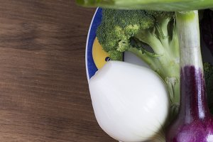 close-up of various onions,broccoli and cabbage on plate