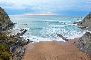 Evening ocean rocky coast.