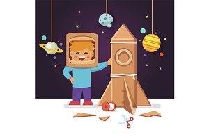 Kid making cardboard box rocket