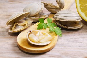 seafood, clams on wooden background