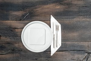 White plate, knife, fork and napkin