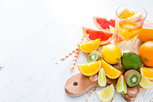 Juice with selection of tropical fruits, isolated on white