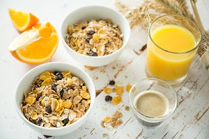 Breakfast - muesli and fruits on white background