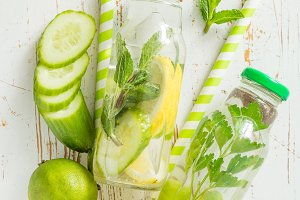 Infused water with citrus and herb in glass bottle