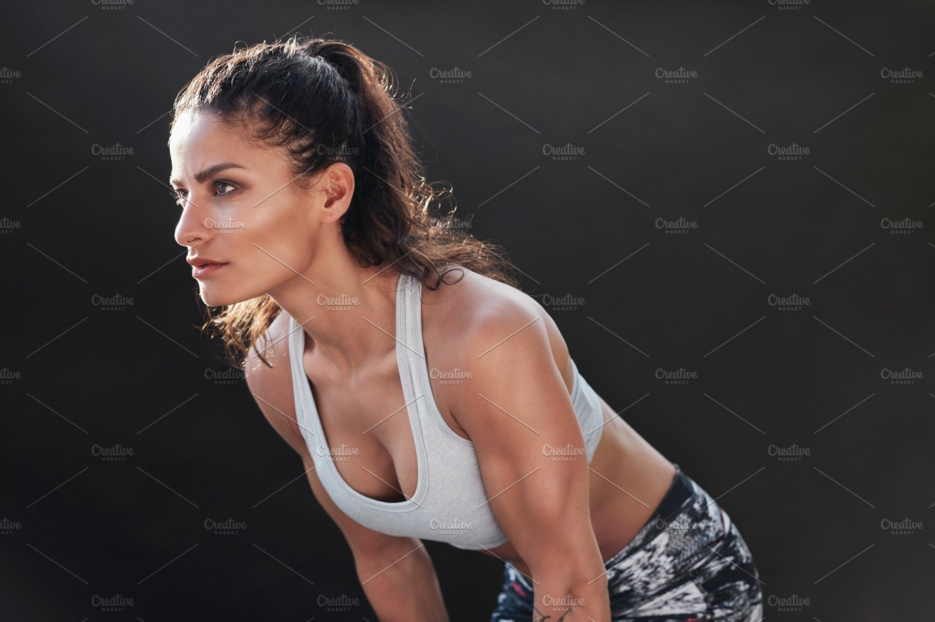Strong woman with muscular body ~ People Images ~ Creative Market